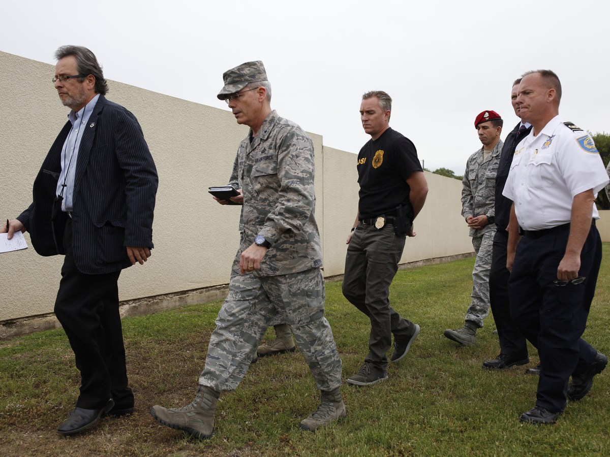 Brigadier General Robert Labrutta walks with Command Officials at Lackland Air Force Base. Photo by Scott Ball