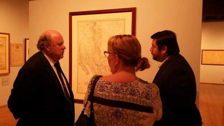 """Bruce Shackelford, Witte Museum's curator of South Texas heritage (left), talks with Jose Barragan, Texas General Land Office's Spanish translator, and Mylynka Cardona, GLO map curator, about the """"Mapping Texas"""" exhibit  on Thursday, April 28, 2016. Photo by Edmond Ortiz."""