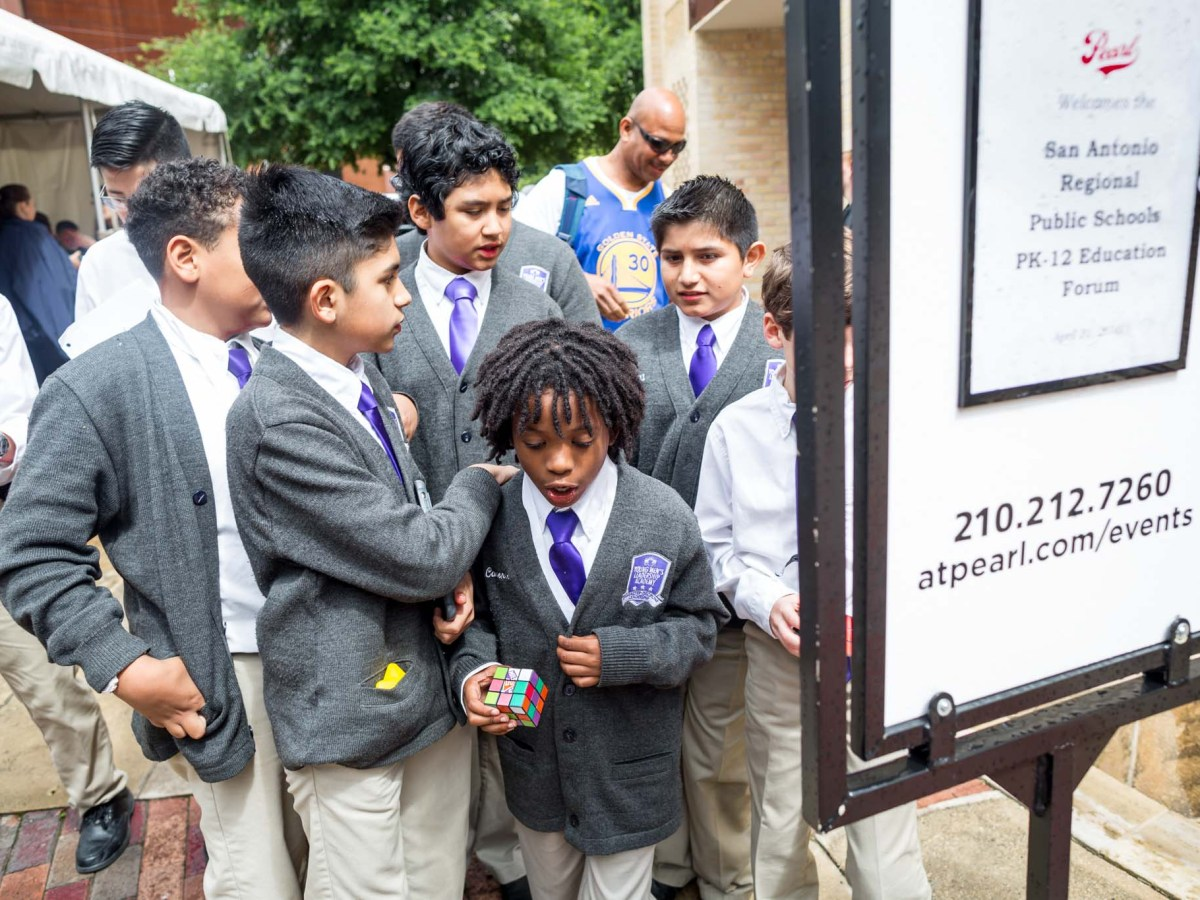 Students of Young Men's Leadership Academy gather in front of the Pearl Stable for the San Antonio Regional Pubic Education Forum. Photo by Michael Cirlos.