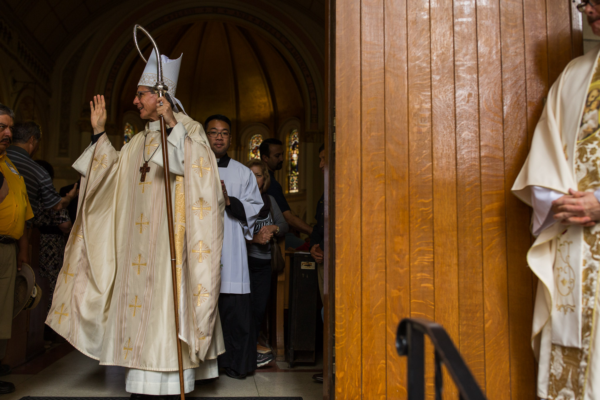 Members of the Catholic clergy led by Archbishop Gustavo García-Siller exit Saint Mary's Catholic Church. Photo by Scott Ball.