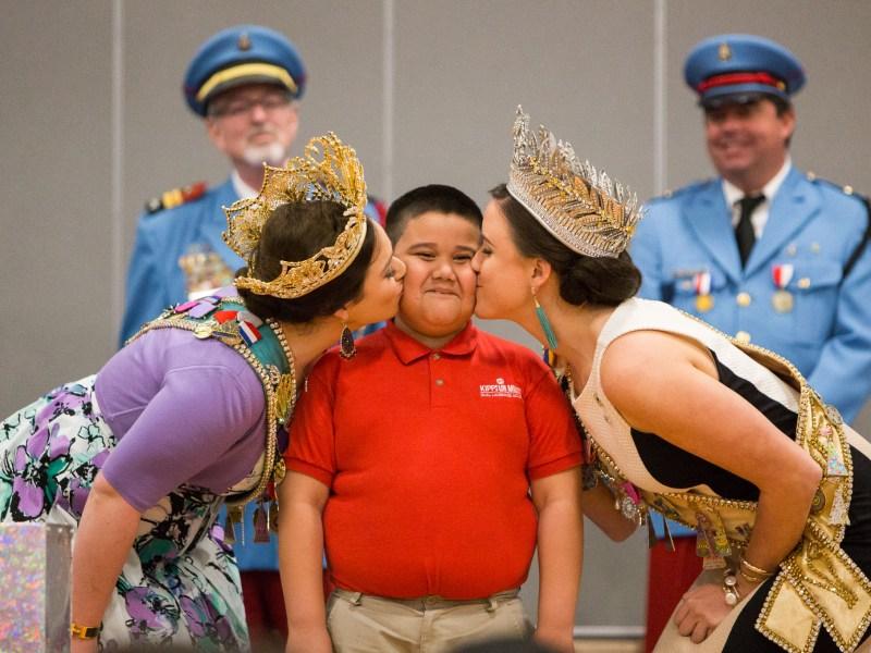 Second-grader Nicholas Esparza receives a royal kiss. Photo by Scott Ball.