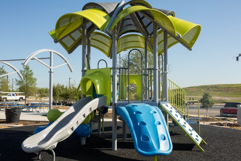 A playscape for younger children atop a spongey material safe for short falls. Photo by Scott Ball.