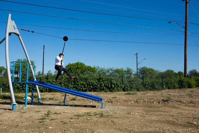 Councilman Ray Saldana (D4) rides the recently installed zip-line. Photo by Scott Ball.
