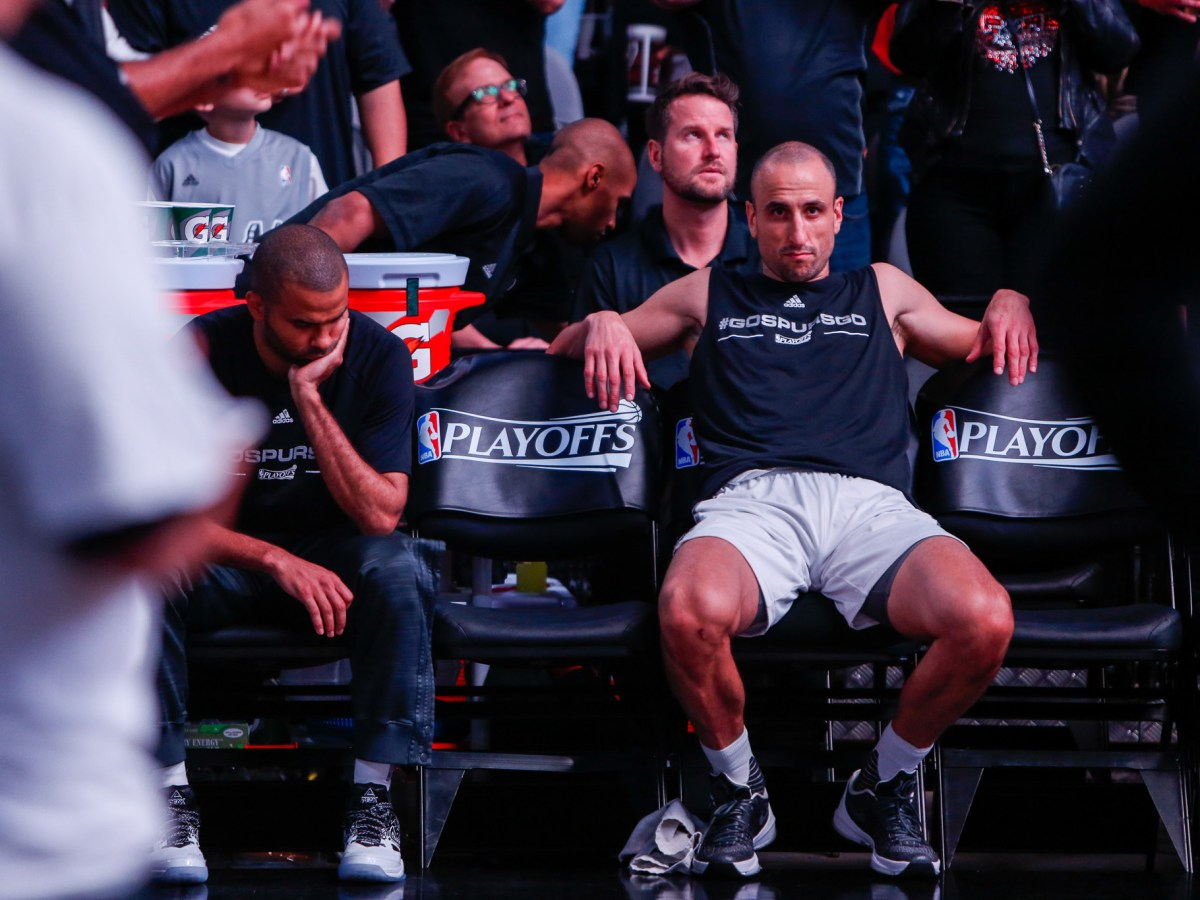 Spurs Forward Manu Ginobili sits on the sidelines during the pre-game introductions. Photo by Scott Ball.