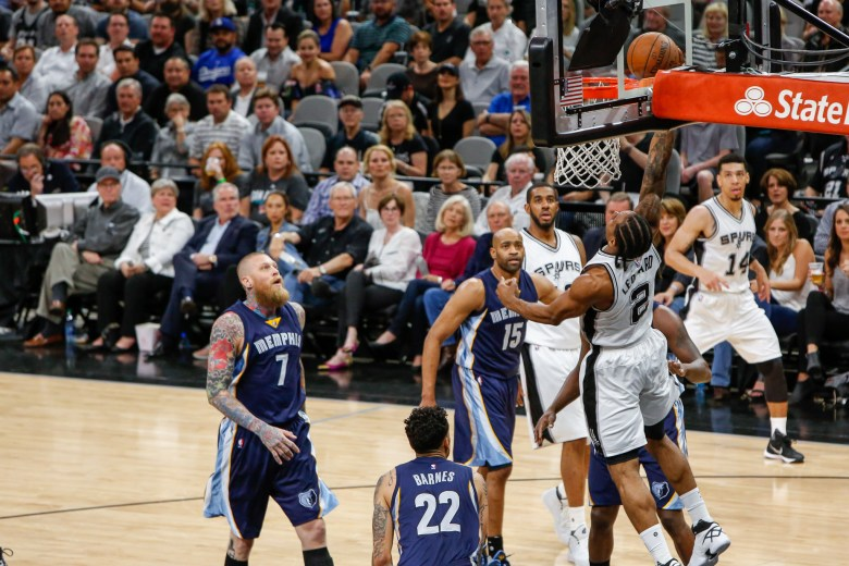 Spurs Forward Kawhi Leonard performs a reverse dunk early in the game. Photo by Scott Ball.
