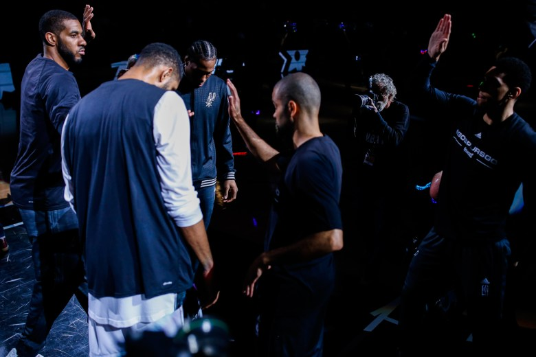 The San Antonio Spurs starting lineup group together moments before tip-off. Photo by Scott Ball.