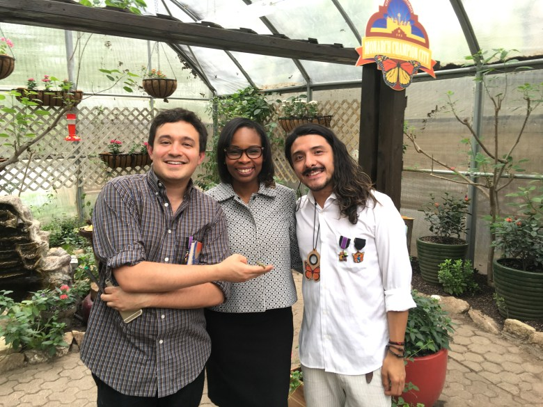 (Left to righ): Andrew Arriaga, Mayor Ivy Taylor, and David Romero smile in the San Antonio Zoo's butterfly exhibit where they were filming an interview with Taylor about the city's commitment to Monarch butterfly preservation. Photo courtesy of Todos Somos Mariposas.