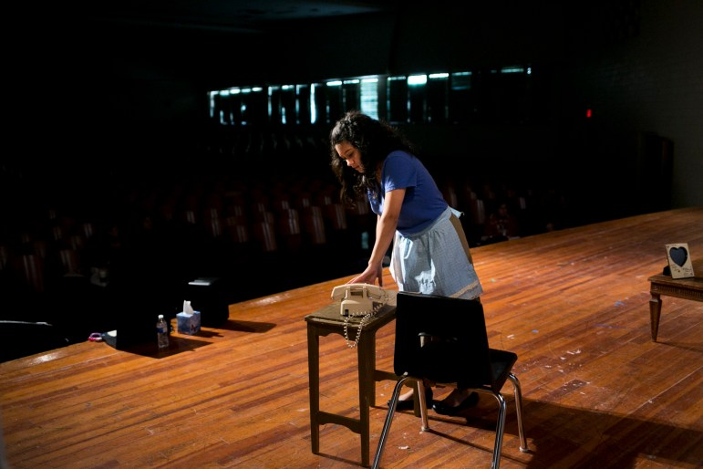 Desiree Gonzales of Lanier High School plays Cenicienta, the stepdaughter who is treated like a lowly servant. Photo by Kathryn Boyd-Batstone