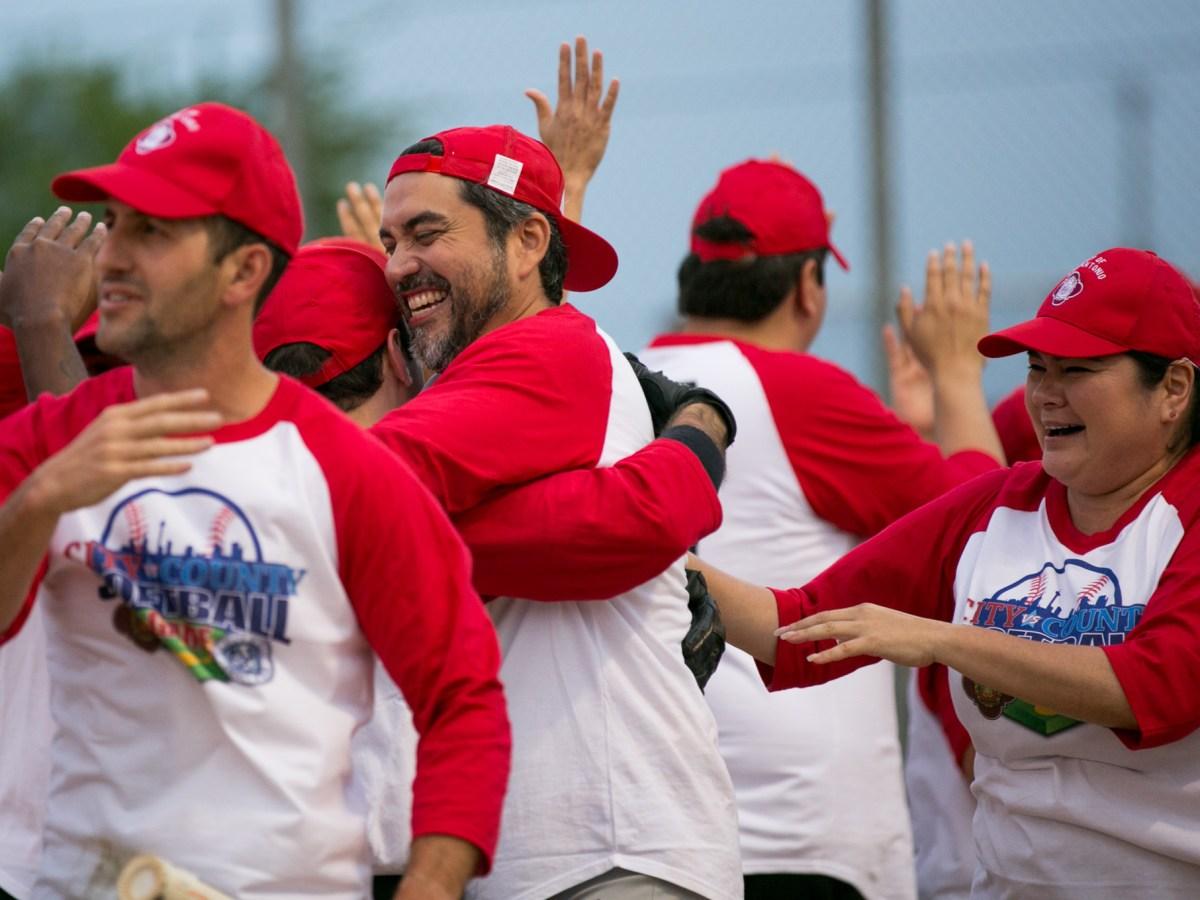 Councilman Roberto Treviño (D1) hugs a teammate in celebration of the win. Photo by Kathryn Boyd-Batstone