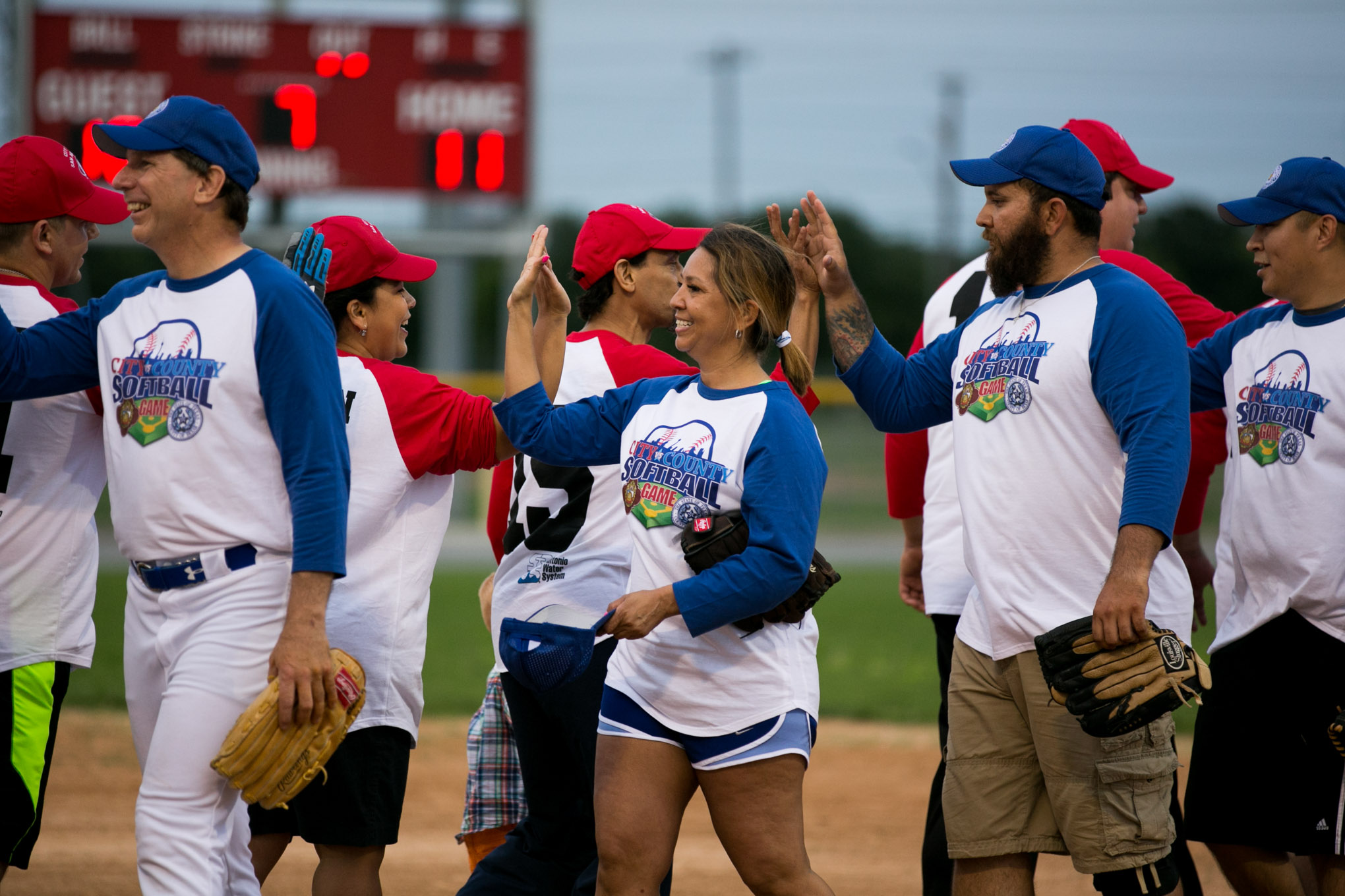 Big Bad Bexars and City Hall of Famers high five after the game. Photo by Kathryn Boyd-Batstone