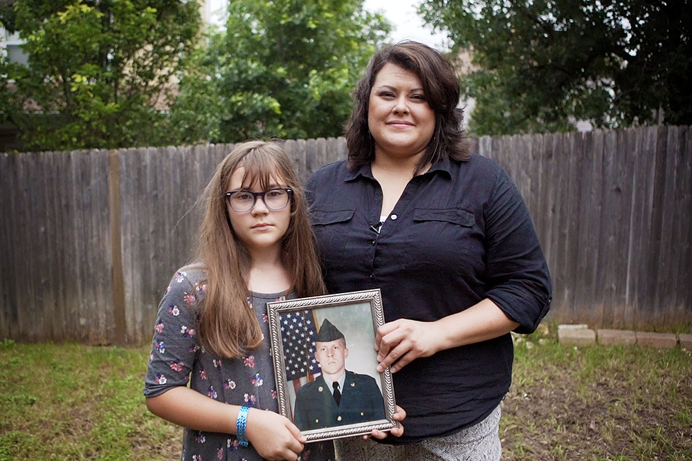 Raquel Scates and her daughter Kendra, age 9, hold a photo of Daniel Scates who was killed in Iraq in 2007. Photo by Kathryn Boyd-Batstone