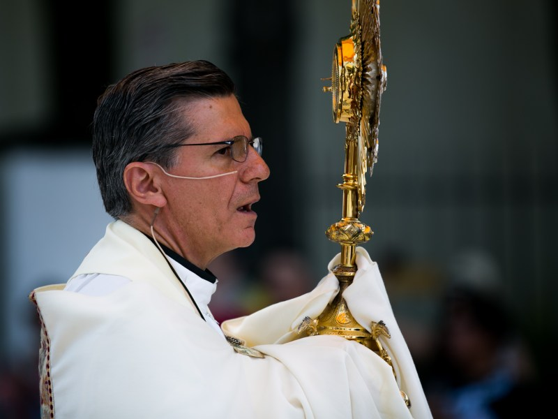 Archbishop Gustavo García-Siller holds the Holy Eucharist. Photo by Kathryn Boyd-Batstone.