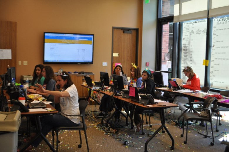 Volunteers for The Big Give SA answer phone calls and keep track of prizes won. Photo by Iris Dimmick.