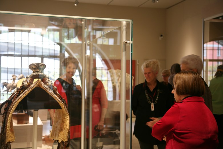 Docent Jan Elliott shows Pancho Villa's saddle to docents from the McNay. Photo courtesy Briscoe Western Art Musuem.