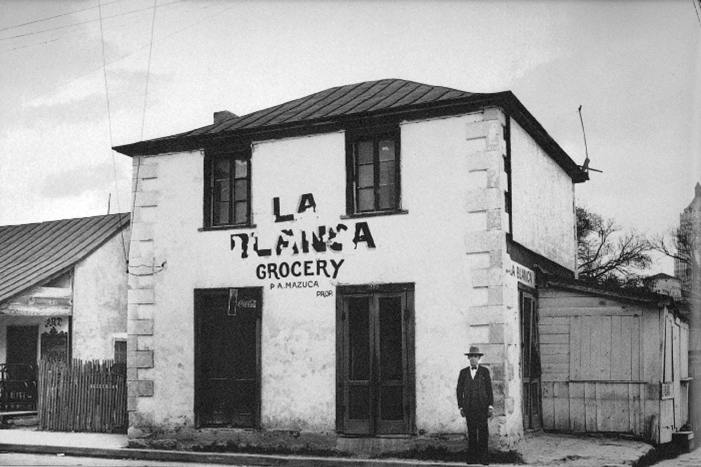 The mercantile building has served as a warehouse, grocery store, restaurant, bar, gift shop, and office. This 1930s photograph is courtesy of the Institute of Texan Cultures.