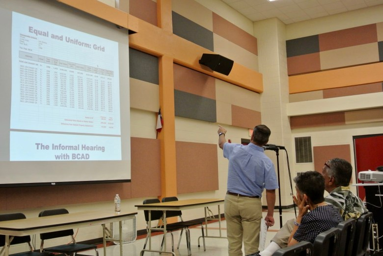 Villarreal presents an graph he created to determine the property appraisals of houses on a single street block. Photo by Sarah Talaat.