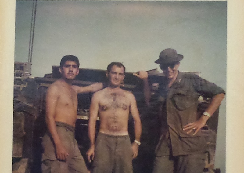 Sgt. Fernando Herrera (left) takes a 15-minute break from military duties with fellow soldiers at base camp in Vietnam, circa 1968. Photo courtesy of Sgt. Fernando Herrera.