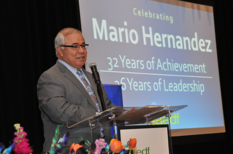Mario Hernandez gives a farewell speech during a luncheon held in honor of his career. Photo courtesy of the San Antonio Economic Development Foundation.