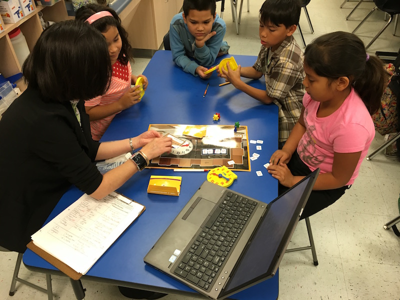 Betsy Barerra works with students in small groups to help them master content as part of the Reasoning Mind curriculum at Stonewall Flanders Elementary School. Photo by Bekah McNeel