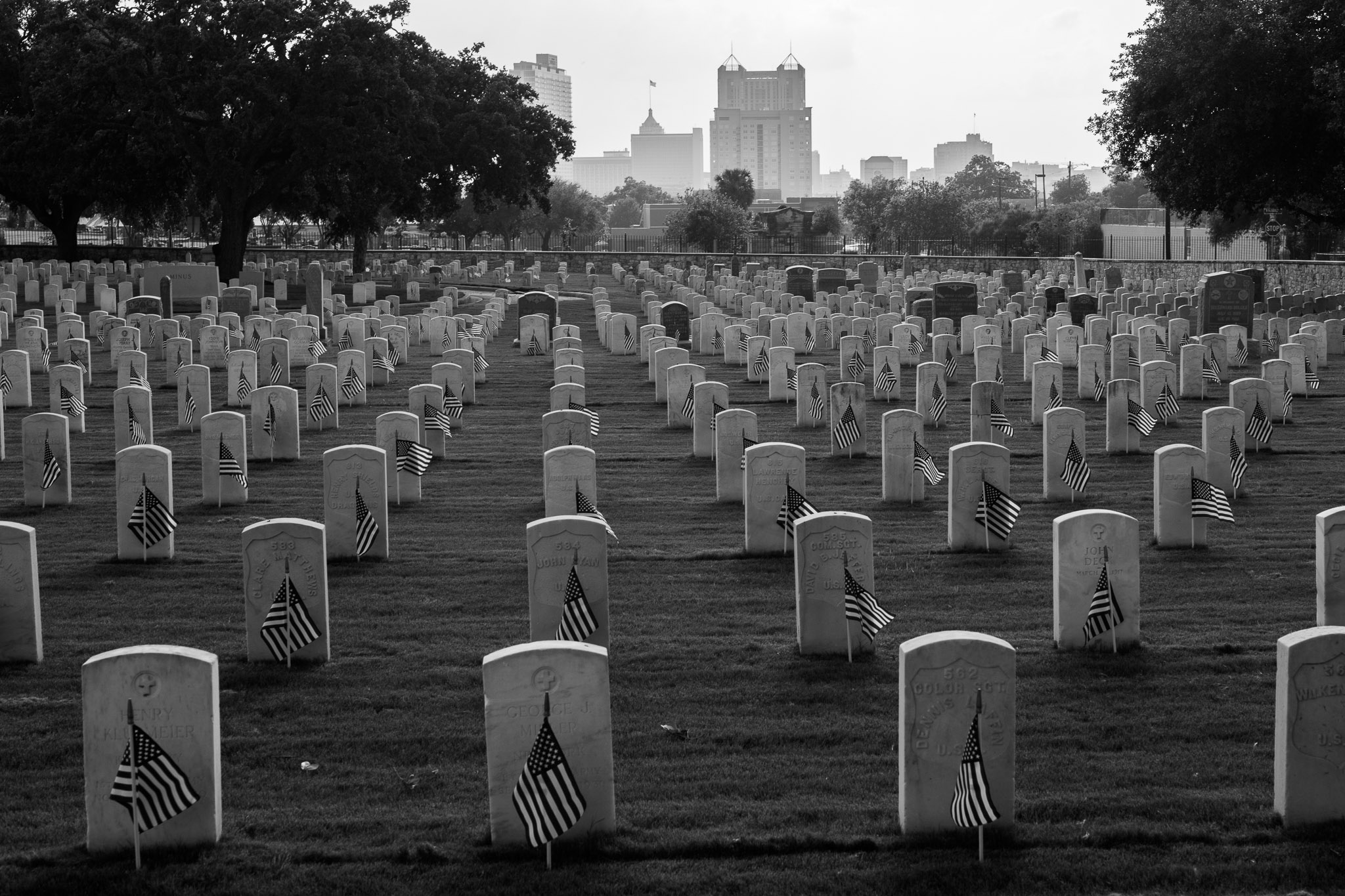 American Flags stand at all grave sites at the San Antonio National Cemetery. Photo by Scott Ball.