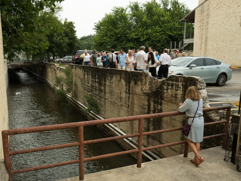 The tour group stands alongside the San Pedro Creek alongside the Alameda Theater in downtown San Antonio. Photo by Scott Ball.