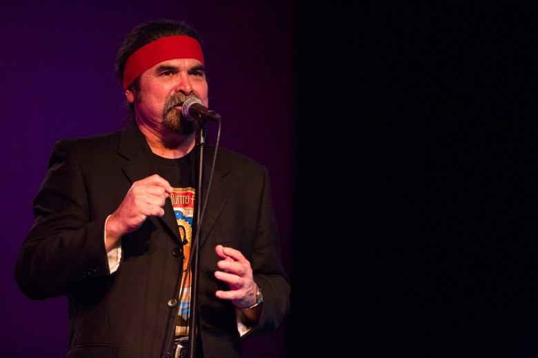 Tejano Conjunto Curator and Co-Founder Juan Tejeda opens up to the audience before the show. Photo by Scott Ball.