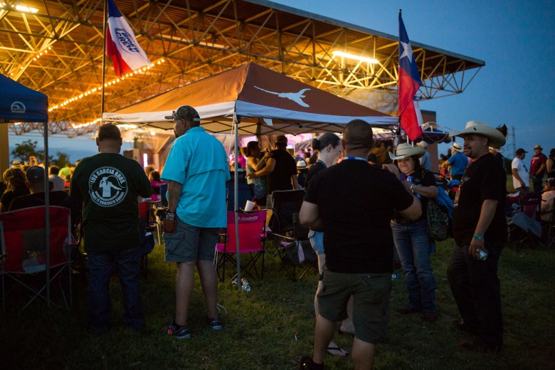 Festival attendees gather outside during a performance. Photo by Scott Ball.