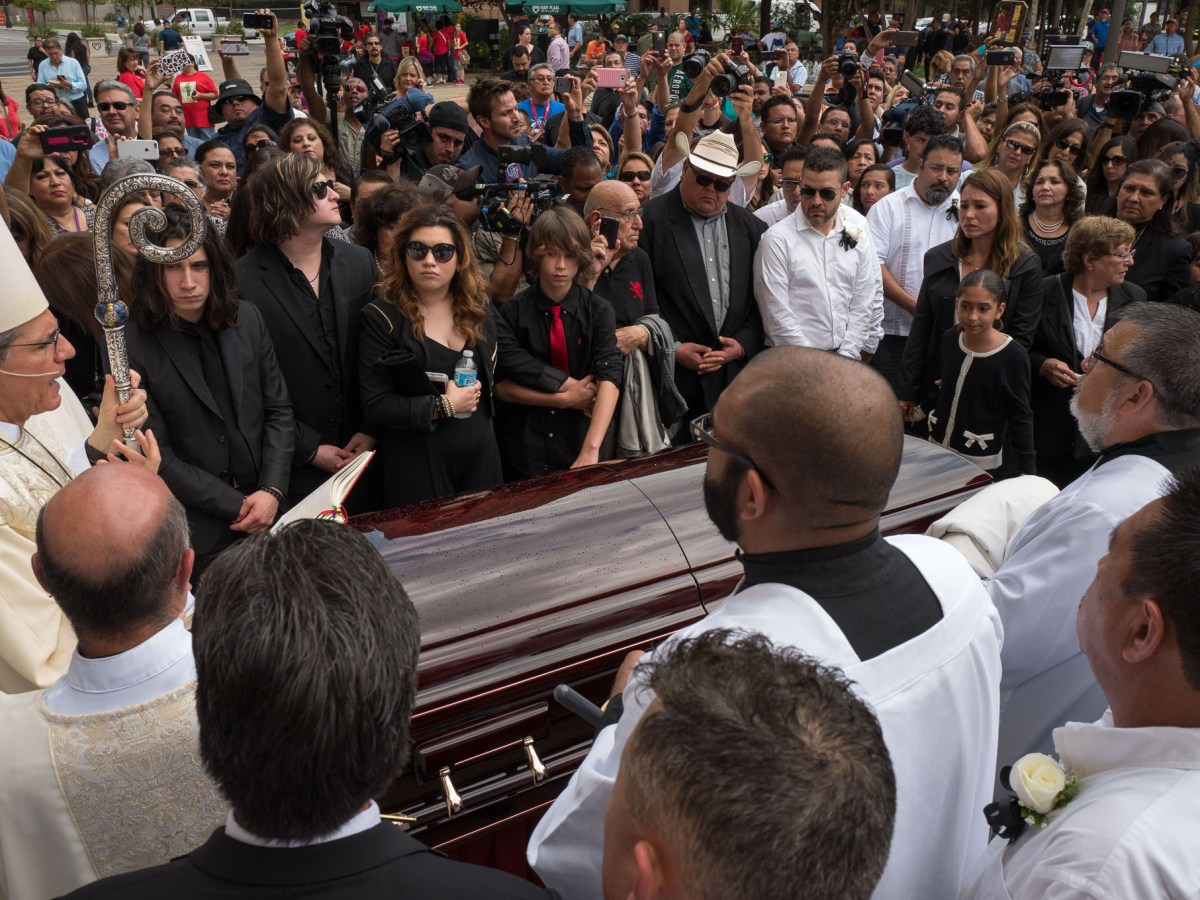 Archbishop Gustavo-García-Siller reads from scripture as family members and fans of Emilio surround. Photo by Scott Ball.