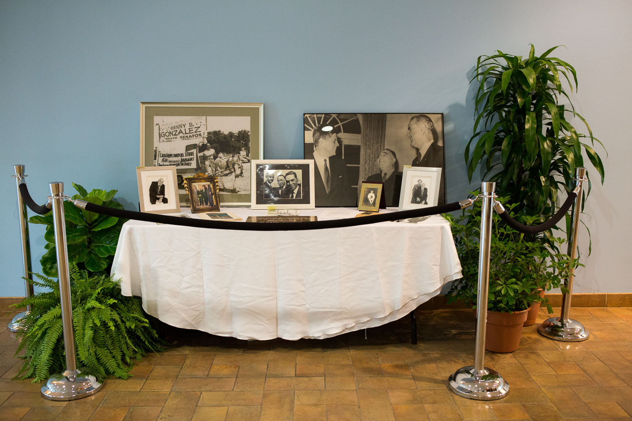 A table displaying historic photographs of Henry B. Gonzalez on display in the Buena Vista Street Building at UTSA Downtown. Photo by Scott Ball.