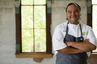 Chef Johnny Hernandez stands for a photo in his home. Photo by Scott Ball.
