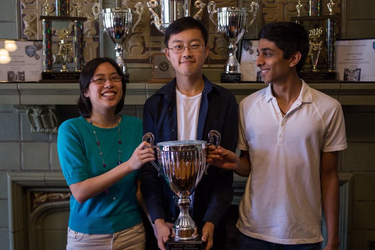 Katie Mansfield, Chris Zhu, and Nabil Kapasi with their Academic WorldQuest trophy. Photo by Scott Ball