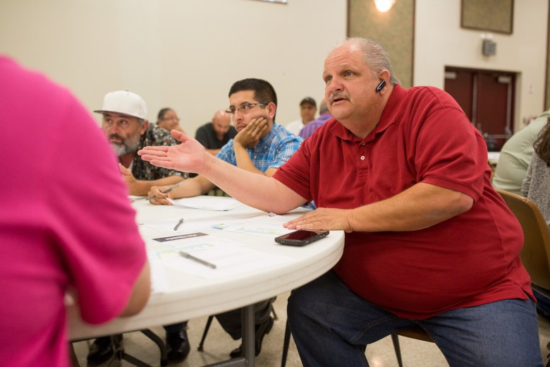 Taxi driver Shawn Jordan talks with other members during the round table discussion. Photo by Scott Ball.