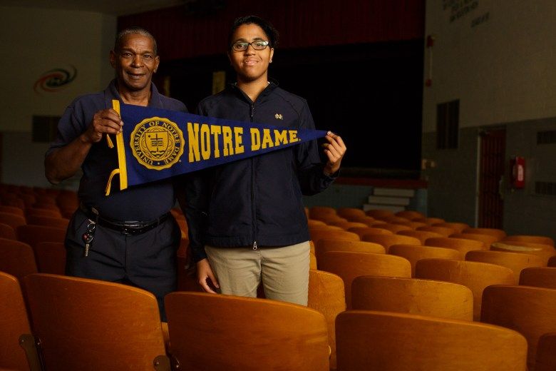 Yahterie-Anne poses with Notre Dame alum Jason Mims. Photo by Scott Ball.