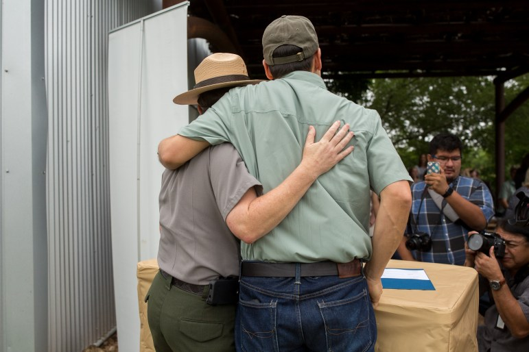 San Antonio Food Bank President and CEO Eric Cooper and Superintendent of the San Antonio Missions National Historical Park Mardi Arce embrace after signing the documents. Photo by Scott Ball.