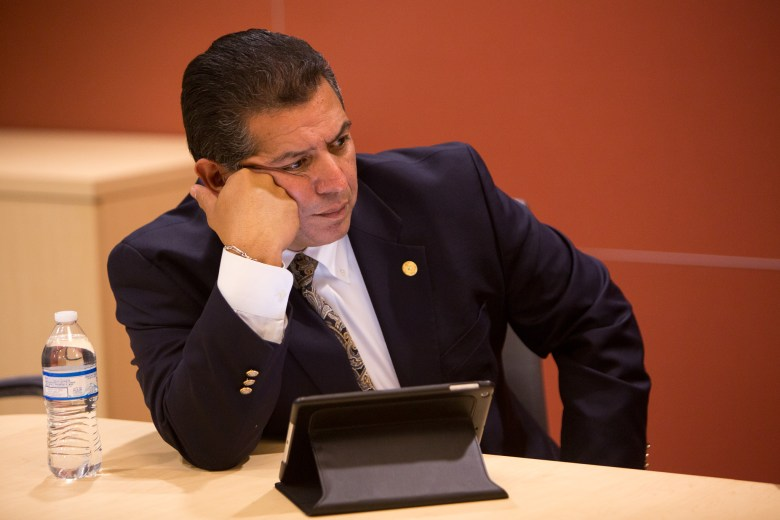 Texas Rep. John Lujan (D118) listens in during a break-out session following the town hall meeting. Photo by Scott Ball.