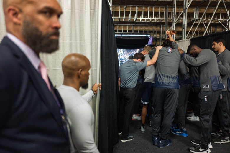 The Oklahoma City Thunder form in a huddle on their way to the court. Photo by Scott Ball.