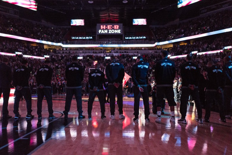 Spurs players line up as the National Anthem is sung. Photo by Scott Ball.