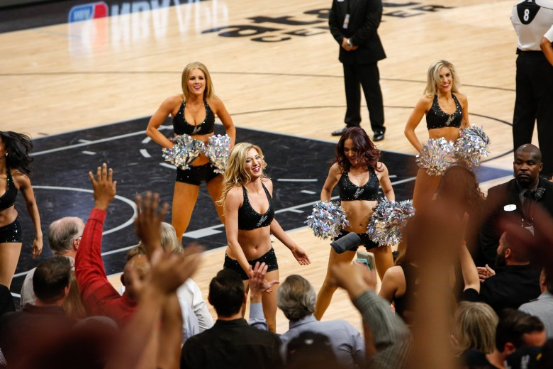 Spurs Silver Dancers perform a routine as they throw shirts to fans. Photo by Scott Ball.