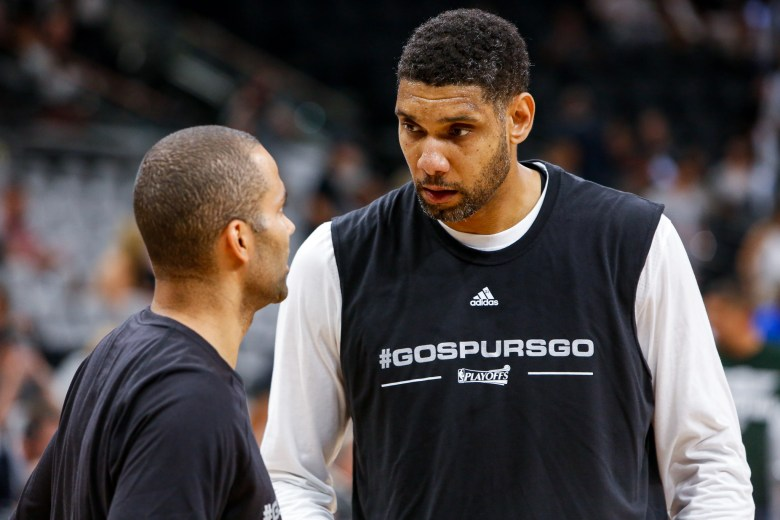 Longtime teammates Tim Duncan and Tony Parker talk before the game. Photo by Scott Ball.