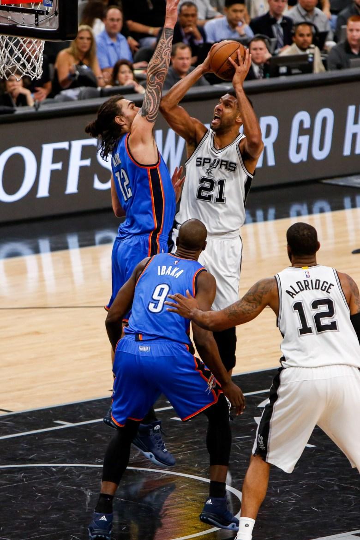 Spurs Center #21 Tim Duncan shoots over Thunder Center #12 Steven Adams. Photo by Scott Ball.