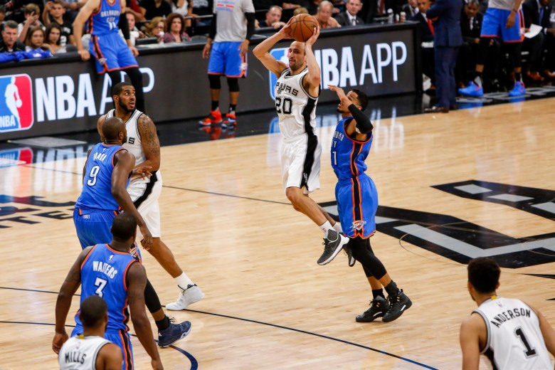 Spurs Forward #20 Manu Ginobili looks to his left before making a no-look pass to Kyle Anderson. Photo by Scott Ball.