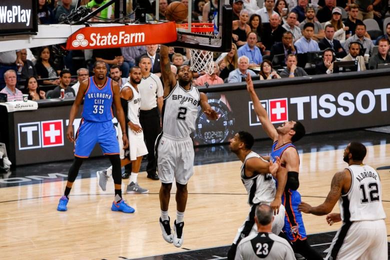 Spurs Forward #2 Kawhi Leonard slams the ball. Photo by Scott Ball.