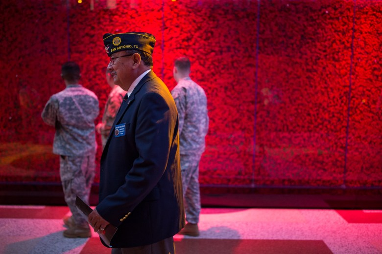 Veteran Arturo Escobar stands in the corridor surrounded by 640,000 poppies. Photo by Scott Ball.