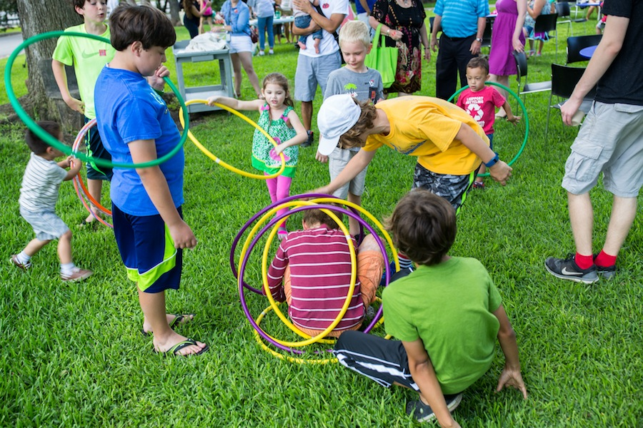 Children play with hula hoops at the McNay Art Museum. Photo by Michael Cirlos.