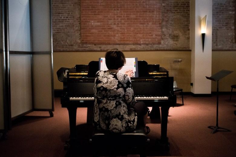 Associate Director Rebecca Morgan works through the piece Nocturnos y Adivinanzas by Cristian Grases. Photo by Kathryn Boyd-Batstone.