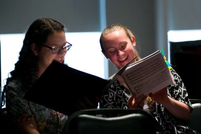 Destiny and Emily laugh as they figure out their part in Nocturnos y Adivinanzas by Cristian Grases. Photo by Kathryn Boyd-Batstone.