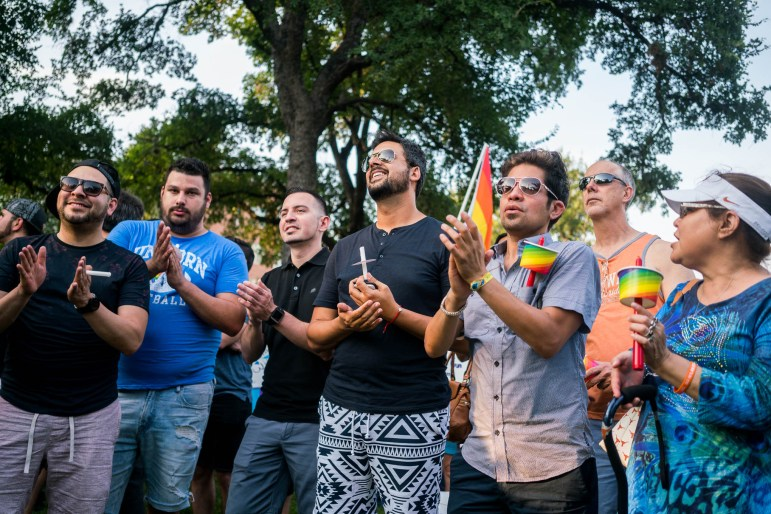 Members of the community clap in support of Equality Texas Vice Chair Julian Tovar's message of love conquers fear. Photo by Kathryn Boyd-Batstone.