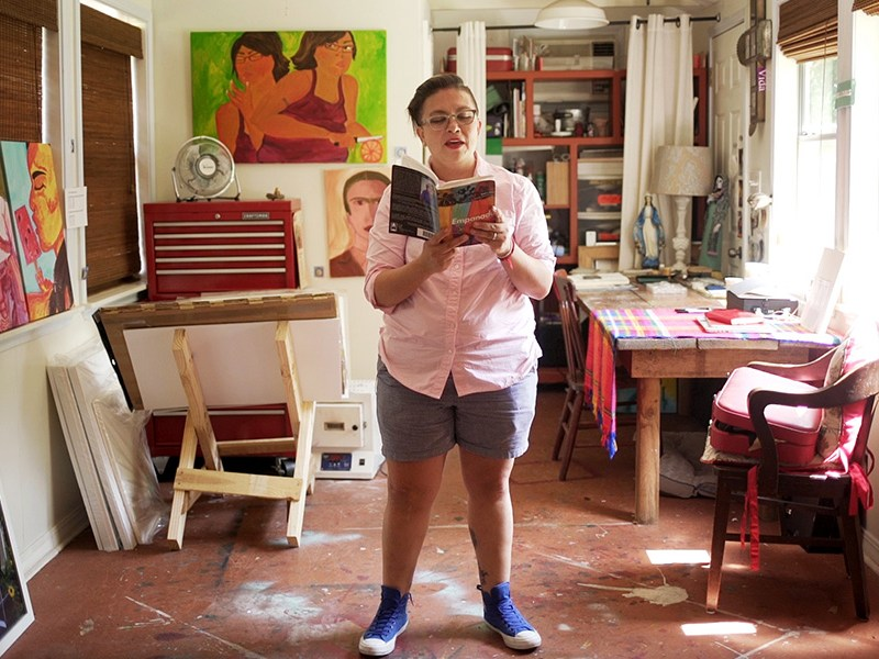Queer artist and author Anel Flores reads from her book Empanada: A Lesbiana Story en Probaditas. Photo by Kathryn Boyd-Batstone.