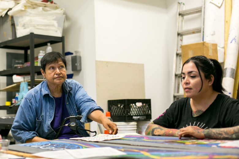 Mary Agnes works with fellow artist on San Antonio Cultural Art Center's 50th mural. Photo by Kathryn Boyd-Batstone