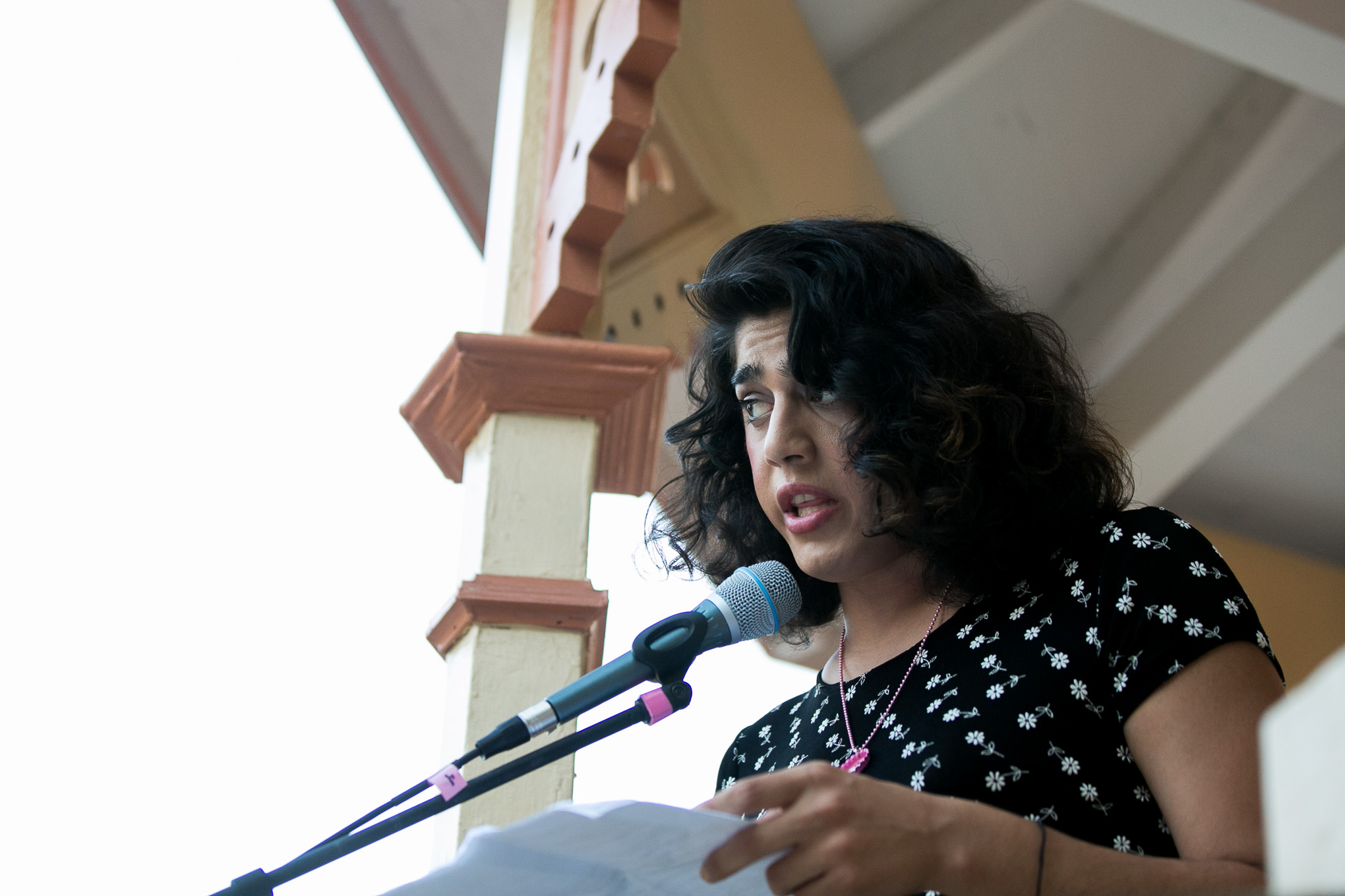 Poet/Author Polly Anna Rocha reads a piece reflecting of the Orlando shooting. Photo by Kathryn Boyd-Batstone.